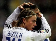 Real Madrid's Guti (L) celebrates with R