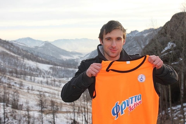 Paul with a shirt displaying the logo of his team sponsor