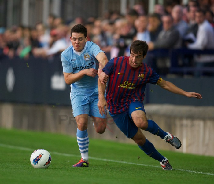 HYDE, ENGLAND - Thursday, September 15, 2011: Manchester City's Joan Angel Roman and FC Barcelona's Eduard Campabadal during the NextGen Series Group 1 match at Ewen Fields. (Pic by David Rawcliffe/Propaganda)