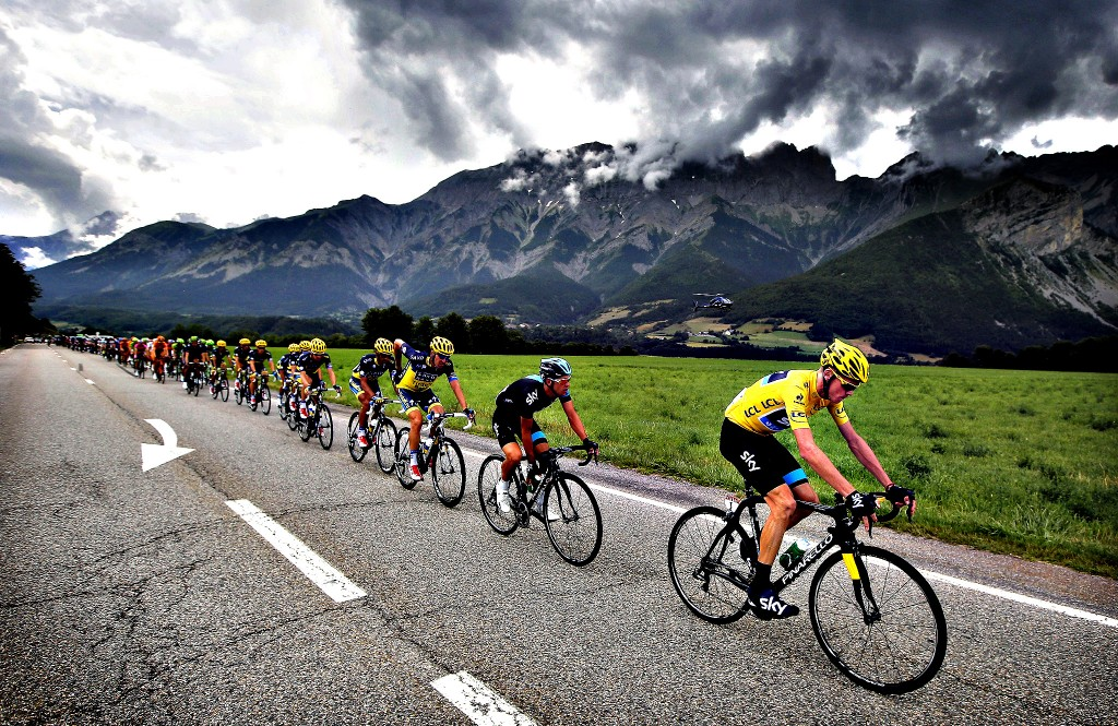 Christopher Froome of Britain, wearing the overall leader's yellow jersey, rides in the pack during the eighteenth stage of the Tour de France cycling race over 172.5 kilometers (107.8 miles) with start in Gap and finish in Alpe-d'Huez, France, Thursday July 18, 2013. (AP Photo/Laurent Cipriani)
