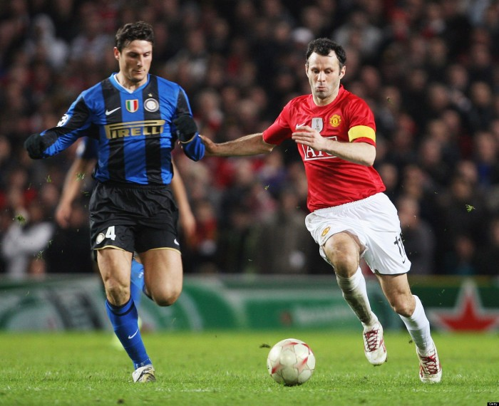 MANCHESTER, ENGLAND - MARCH 11: Ryan Giggs of Manchester United clashes with Javier Zanetti of Inter Milan during the UEFA Champions League First Knockout Round Second Leg match between Manchester United and Inter Milan at Old Trafford on March 11 2009 in Manchester, England. (Photo by John Peters/Manchester United via Getty Images)