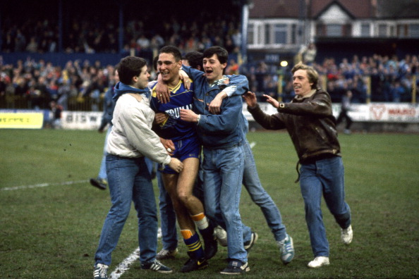 12 March 1988 FA Cup 6th Round - Wimbedon v Watford - Vinnie Jones is mobbed by celebrating Wimbledon fans as they invade the Plough Lane pitch. (Photo by Mark Leech/Getty Images)