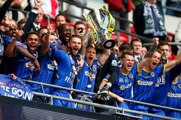 LONDON, ENGLAND - MAY 30: Barry Fuller of Wimbledon lifts the trophy with his teammates after they win the Sky Bet League Two Play Off Final match between Plymouth Argyle and AFC Wimbledon at Wembley Stadium on May 30, 2016 in London, England. (Photo by Jordan Mansfield/Getty Images)