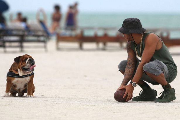 Lewis-Hamilton-takes-his-dog-for-a-walk-while-riding-a-unicycle