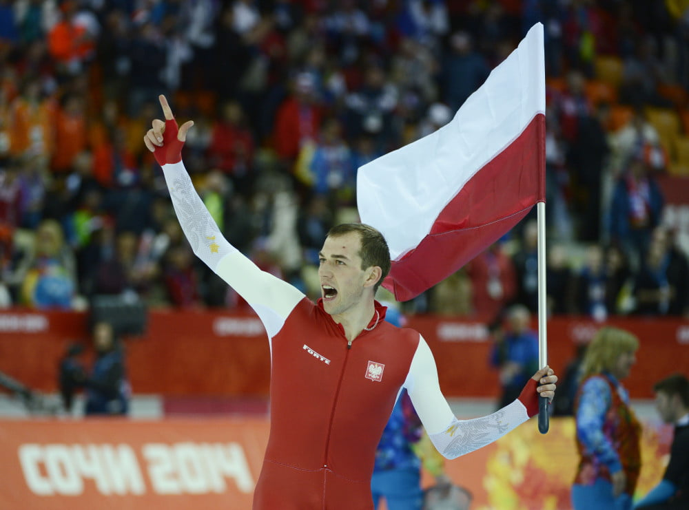 Feb 15, 2014; Sochi, RUSSIA; Zbigniew Brodka of Poland celebrates his gold medal in speed skating men's 1500m during the Sochi 2014 Olympic Winter Games at Adler Arena Skating Center. Mandatory Credit: Robert Hanashiro-USA TODAY Sports