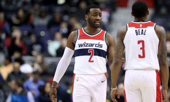 WASHINGTON, DC - DECEMBER 13: John Wall #2 and Bradley Beal #3 of the Washington Wizards talk during the second half against the Memphis Grizzlies at Capital One Arena on December 13, 2017 in Washington, DC. NOTE TO USER: User expressly acknowledges and agrees that, by downloading and or using this photograph, User is consenting to the terms and conditions of the Getty Images License Agreement. (Photo by Rob Carr/Getty Images)