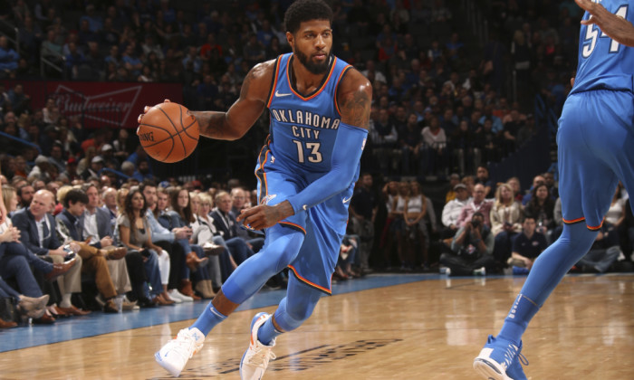 OKLAHOMA CITY, OK - MARCH 6: Paul George #13 of the Oklahoma City Thunder handles the ball against the Houston Rockets on March 6, 2018 at Chesapeake Energy Arena in Oklahoma City, Oklahoma. NOTE TO USER: User expressly acknowledges and agrees that, by downloading and or using this photograph, User is consenting to the terms and conditions of the Getty Images License Agreement. Mandatory Copyright Notice: Copyright 2018 NBAE (Photo by Layne Murdoch Sr./NBAE via Getty Images)