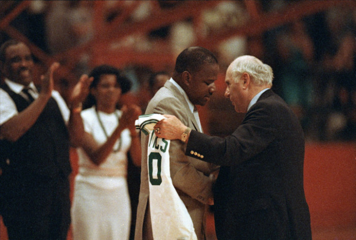 "Boston Celtics' president Arnold ""Red"" Auerbach, right, presents a team jersey to Len Bias' father James Bias during a tribute to the late basketball star at College Park, June 24, 1986. Bias, who was headed for a pro career in Boston, died in his University of Maryland dormitory Thursday. (AP Photo/Bill Smith)"