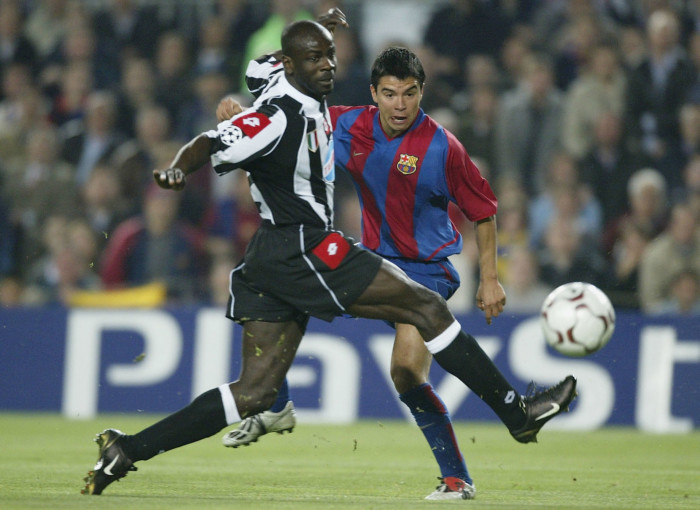 BARCELONA - APRIL 22: Javier Pedro Saviola of Barcelona shoots past Lilian Thuram of Juventus during the UEFA Champions League Quarter-Final second leg match between Barcelona and Juventus at the Nou Camp Stadium on April 22, 2003 in Barcelona, Spain. (Photo by Alex Livesey/Getty Images)