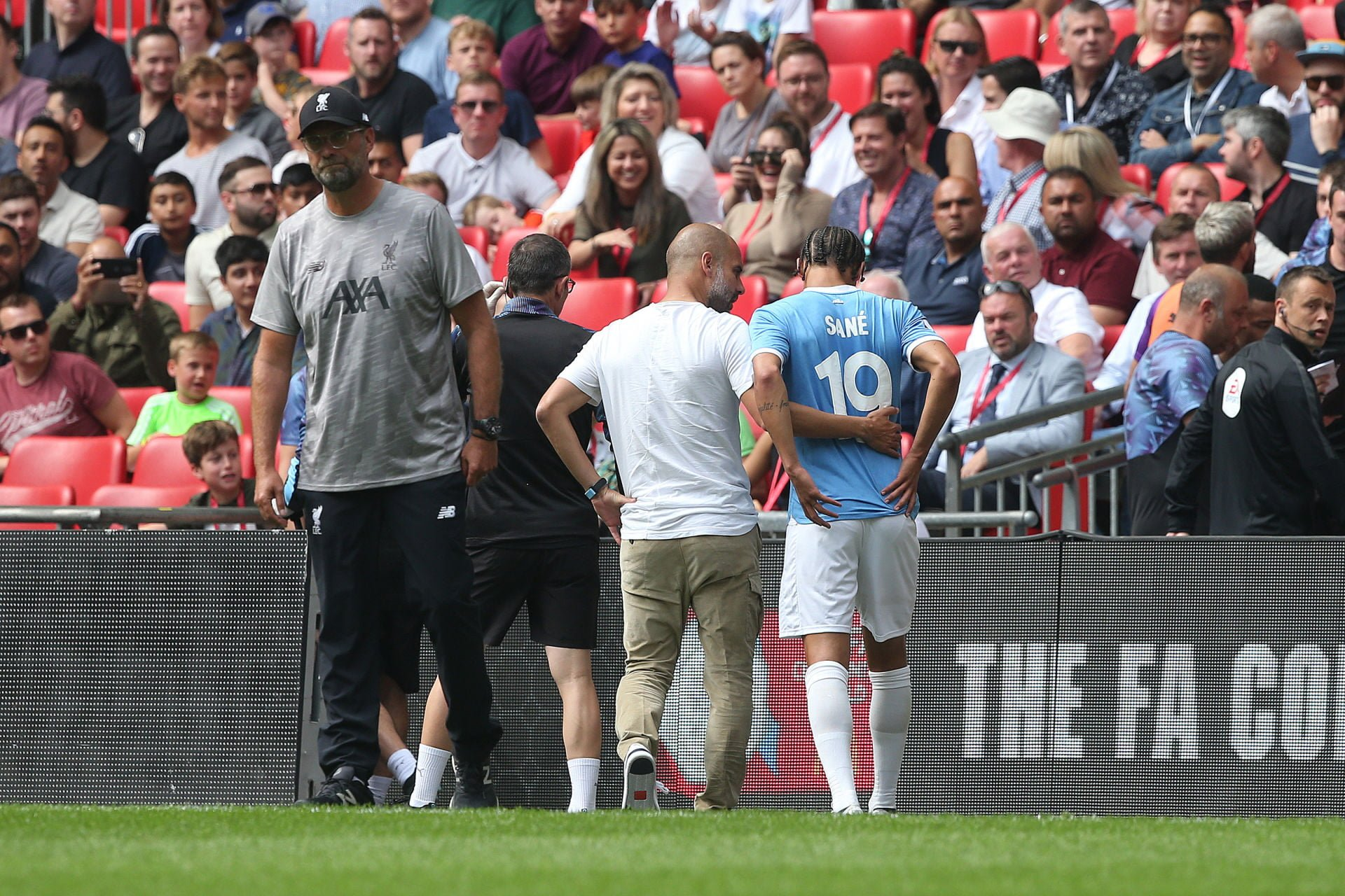 04.08.2019, Wembley Stadion, London, ENG, Community Shield, FC Liverpool vs Manchester City, im Bild Manchester City Manager Pep Guardiola consoles Leroy Sane of Manchester City as he leaves the match through injury early on // Manchester City Manager Pep Guardiola consoles Leroy Sane of Manchester City as he leaves the match through injury early on during the Community Shield Match between FC Liverpool and Manchester City at the Wembley Stadion in London, Great Britain on 2019/08/04. EXPA Pictures © 2019, PhotoCredit: EXPA/ Focus Images/ Paul Chesterton *****ATTENTION - for AUT, GER, FRA, ITA, SUI, POL, CRO, SLO only***** TARCZA WSPOLNOTY PILKA NOZNA FOT.EXPA/NEWSPIX.PL Austria, Italy, Spain, Slovenia, Serbia, Croatia, Germany, UK, USA and Sweden OUT! --- Newspix.pl *** Local Caption *** www.newspix.pl mail us: info@newspix.pl call us: 0048 022 23 22 222 --- Polish Picture Agency by Ringier Axel Springer Poland