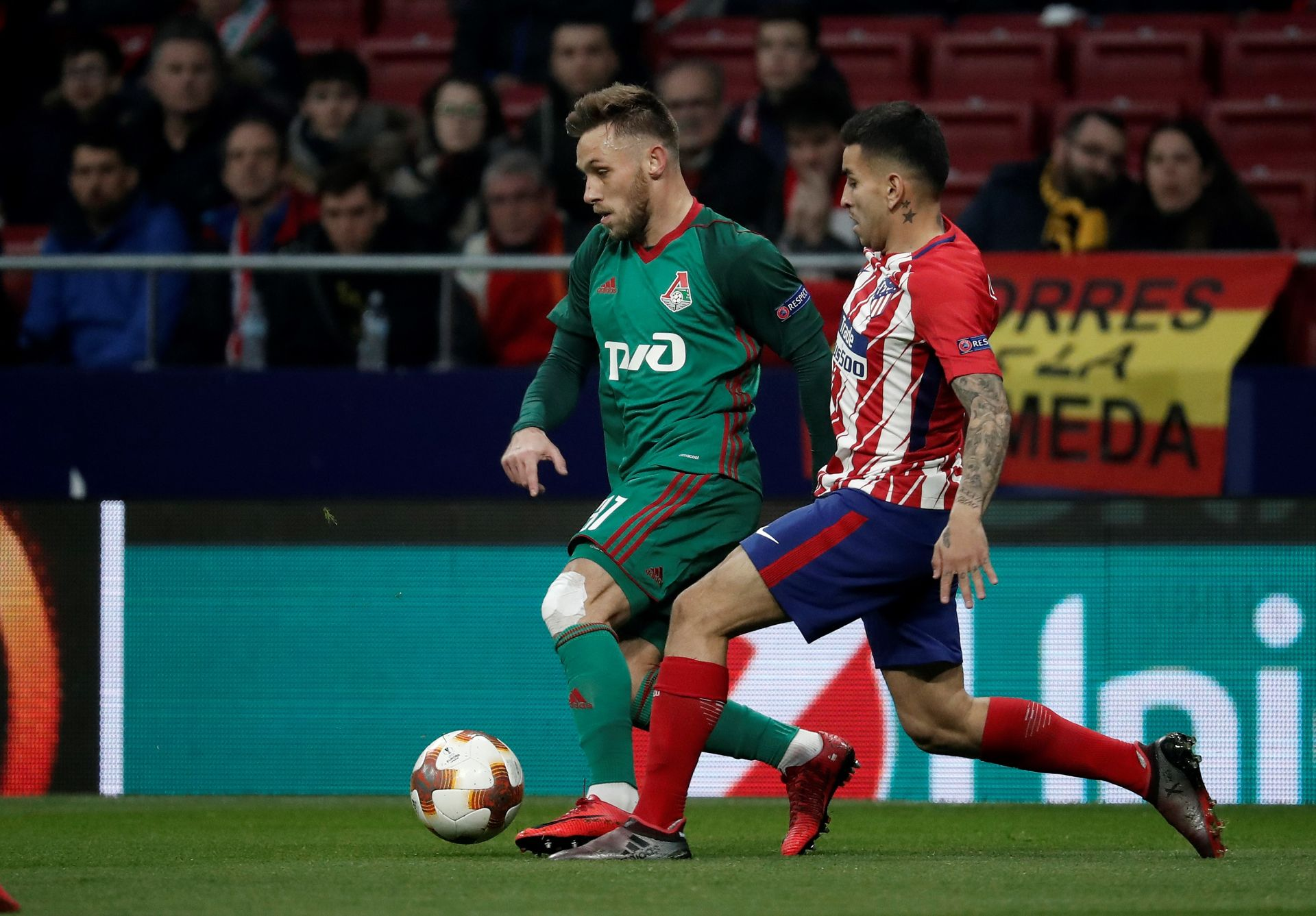 MADRID, SPAIN - MARCH 8: Angel Correa (R) of Atletico Madrid in action against Maciej Rybus (L) of Lokomotiv Moscow during the UEFA Europa League Round of 16 soccer match between Atletico Madrid and Lokomotiv Moscow at Wanda Metropolitano Stadium in Madrid, Spain on March 8, 2018. Burak Akbulut / Anadolu Agency LIGA EUROPY PILKA NOZNA SEZON 2017/2018 FOT.ABACA/NEWSPIX.PL POLAND ONLY!!! --- Newspix.pl *** Local Caption *** www.newspix.pl mail us: info@newspix.pl call us: 0048 022 23 22 222 --- Polish Picture Agency by Ringier Axel Springer Poland