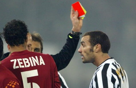 ROME, ITALY: Paolo Montero (R) of Juventus receives the red card during the soccer match against AS Roma at the Olympic stadium in Rome, 08 February 2004. AS Roma won the match 4-0. AFP PHOTO/ Vincenzo PINTO (Photo credit should read VINCENZO PINTO/AFP/Getty Images)