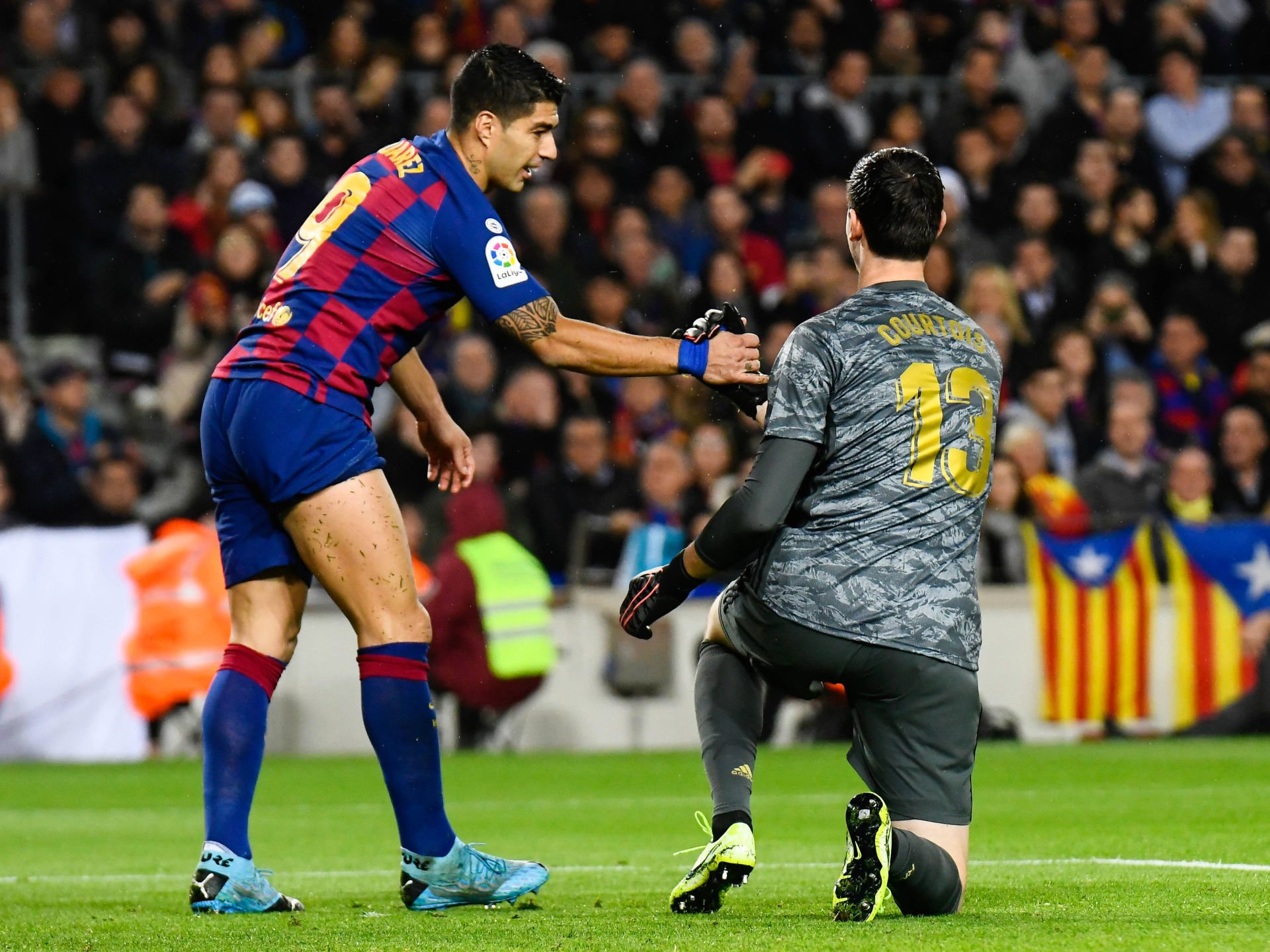 Luis Suarez of FC Barcelona and Thibaut Courtois of Real Madrid during the Liga match between Barcelone and Real Madrid at Camp Nou on December 18, 2019 in Barcelona, Spain. (Photo by Pressinphoto/Icon Sport) LIGA HISZPANSKA PILKA NOZNA SEZON 2019/2020 FOT. ICON SPORT/NEWSPIX.PL POLAND ONLY! --- Newspix.pl *** Local Caption *** www.newspix.pl mail us: info@newspix.pl call us: 0048 022 23 22 222 --- Polish Picture Agency by Ringier Axel Springer Poland