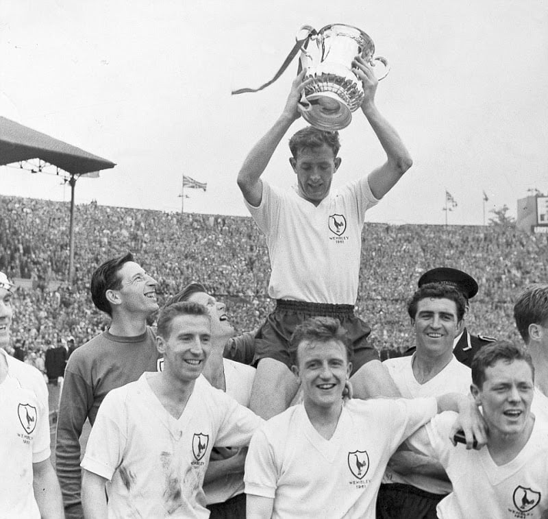 Tottenham Hotspur and Northern Ireland football captain Danny Blanchflower was happy to celebrate on the football pitch, here holding the FA Cup aloft after winning the 1961 final against Leicester City to win the league and cup ÔdoubleÕ.