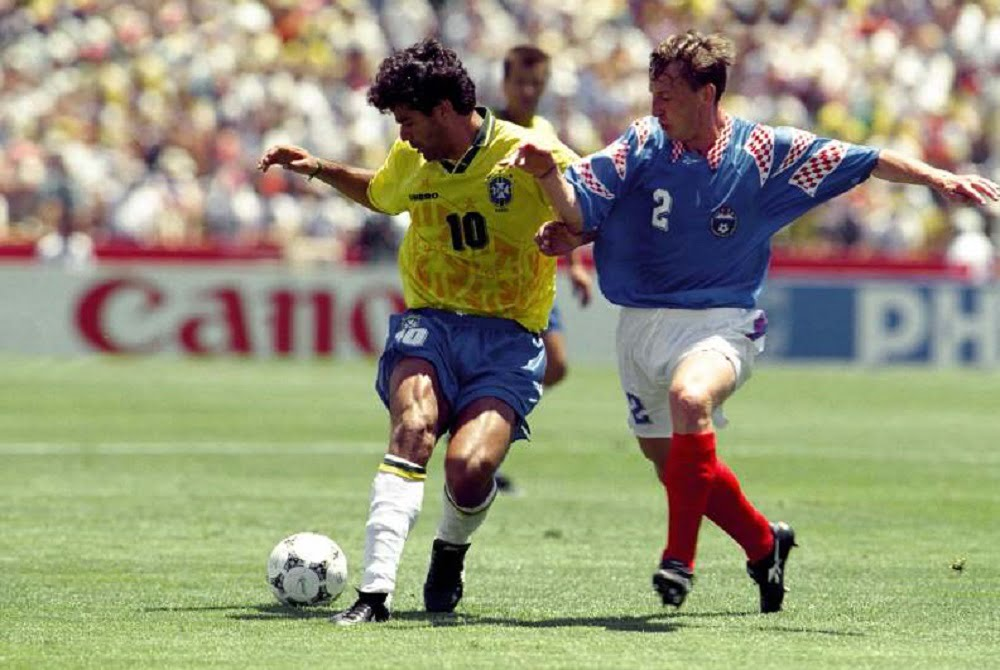 Football - World Cup 1994 , Group B , Boston , Brazil v Russia , 20/6/94 Rai - Brazil in action against Dmitri Kuznetsov - Russia Mandatory Credit:ActionImages / Action Images